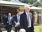 Tweed Deputy Mayor Gary Bagnall, left, leaves Murwillumbah Local Court with his legal team, headed by solicitor Russell Baxter, right, after pleading not guilty to charges of assault and intimidation.