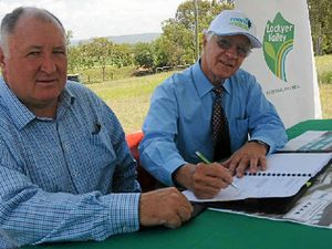 DEAL DONE: Lockyer Valley Mayor Steve Jones signs the contract with Allan Buckley of AB Group for the construction of a motel in Gatton.