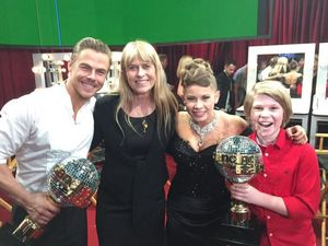 Bindi Irwin and her dance partner Derek Hough triumphant with their winner's trophy backstage with mum Terri and brother Bob.