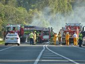 Police have confirmed that a person has died in a fiery crash between a semi-trailer and a car on the Pacific Highway at Woodburn this afternoon.