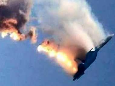 An image grab made from a video shows a burning Russian fighter jet coming down after being shot down near the Turkish-Syrian border. Picture: AFP