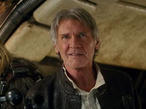 Peter Mayhew (as Chewbacca) and Harrison Ford in a scene from the movie Star Wars: The Force Awakens.