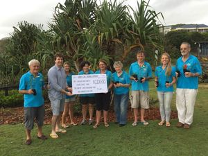 COASTCARE: Coolum and North Shore Coast Care members accept cheque from Duncan Yorkston of Sandy Cove Trading Company. Photo Contributed