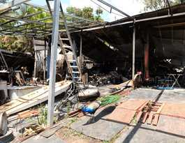 Sheds blaze cause unclear and investigations continuing