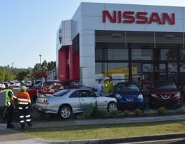 Car crashes into Nissan yard