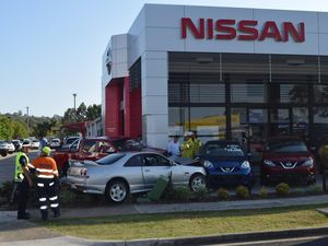 Emergency services investigate a single vehicle crash on Wises Rd at Maroochydore.