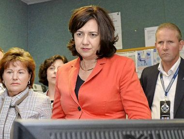 Jo-Ann Miller (left) and Premier Annastacia Palaszczuk on a tour of the Ipswich police communications centre.