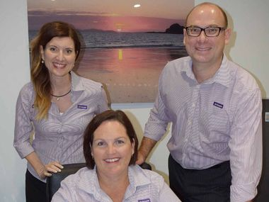 NEW OFFICE: Aussie Rockhampton owners Brendan and Michelle Ryan with mortgage broker Anna Smith, who is part of their team and now operating from Yeppoon.