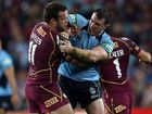 Paul Gallen (right) goes after Queensland forward Nate Myles in their highly publicised State of Origin stoush during the 2013 series.