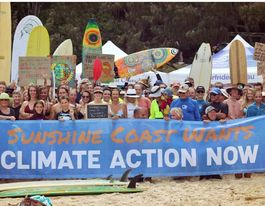 Paddle-out shows mood for change on climate