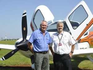 Ready for takeoff are FKG company pilot Glenn Atkinson with Cirrus Aircraft sales manager Andy Hartel.