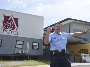 Gladstone's dancing cop Constable Dominic McGee broke up the boredom of traffic controlling over the weekend with some fun moves. Photo Campbell Gellie / The Observer