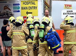 EVACUATIONS: Emergency services enter Lismore Base Hospital where scaffolding collapsed during a wild storm yesterday afternoon.