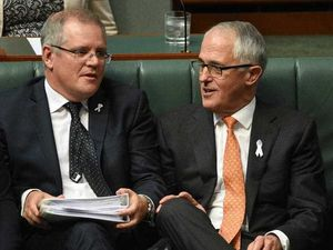 Treasurer Scott Morrison (L) and Prime Minister Malcolm Turnbull during Question Time at Parliament House in Canberra on Tuesday, Nov. 24, 2015.
