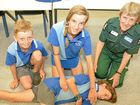 Fay Gleave teaches first-aid to Condong Primary students Reif Watson, Phoebe Pereira and Max Milne.