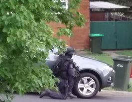 Police siege after reports of armed man