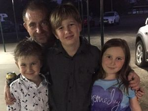 Bruce Mitchell, pictured with his children, was killed in a hit and run at Oakey on Sunday night.