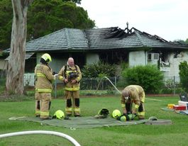 Firies on the scene of house fire in Casino