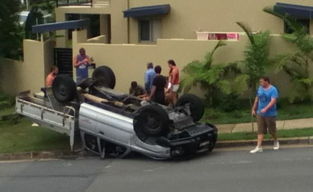 Car flips onto pedestrian crossing trouble spot. - User Contributed