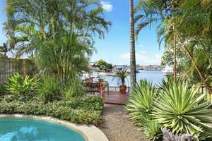 Sit back, relax and enjoy lovely long water views to the yachts at the marina in this tranquil waterfront setting in prestigious Minyama.  Immaculately presented, this single level family home is cleverly designed to showcase the fabulous water views, and is ideal for a range of buyers from a growing ...