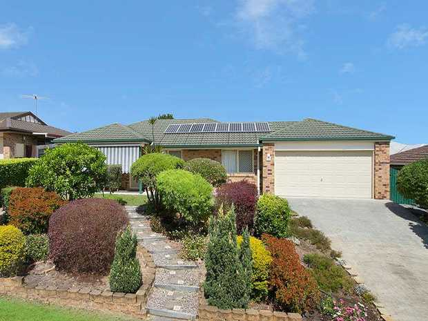 This large family home is offered for sale and is sure to impress. The home has been beautifully loo...