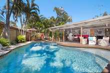 Once you step behind the gates of this ideal 'Endless Summer' home it's hard to believe you're only minutes from the white sand of Coolangatta, popular shopping facilities and the Gold Coast International airport.   At the end of a quiet cul-de-sac, the rendered home sits on a spacious ...
