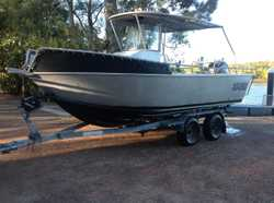 Centre console 6.95m alloy plate boat on tandem trailer. Both registered. VHF radio raymarine Hybird...