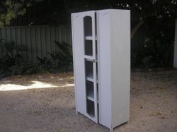 Storage cabinet , 5 shelves , app 174 h x 89 w 42 d good condition. Open style central door As per p...