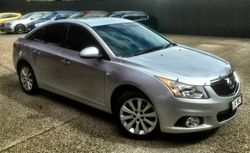 Located at the Gateway to the Whitsundays! 2014 Holden Cruze JH Series II Z Series Sedan! 6 Speed Ma...