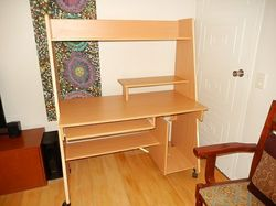 bench veneer,clean gc.slide out shelf,top/bottom shelves, on castors easy to move around, can assist...