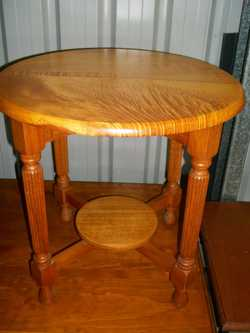 - round timber retro occasional table with stunningl  detailing. Can deliver.