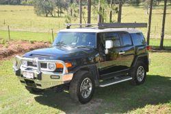 Toyota FJ Cruiser Auto 4x4 MY14 has Dark tinted windows, Genuine Toyota towbar, ECB airbag certified...