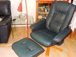 wooden base, blue leatherlook.large comfy,high back, can assist with local delivery after viewing.