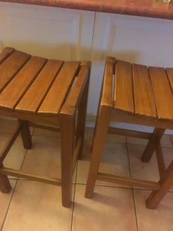 4 wooden bar stools