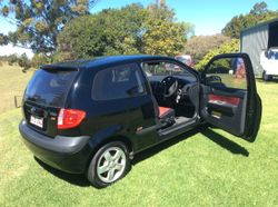 Black, with black and red interior. 11 months rego, log books, road worthy certificate.