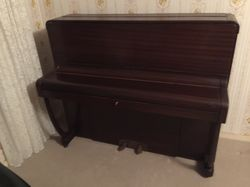 Solid wood upright piano. Excellent condition. One owner. Well maintained and regularly tuned. LOCAL...