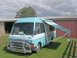 MAZDA 3000 Diesel Motorhome. 3 single beds, 2 roll out awings, reversing camera, good duco &...