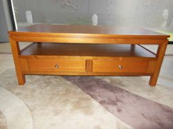 COFFEE TABLE Solid timber or TV unit, perfect cond, 2 drawers, 125 x 63 x 47H, $295 ono. Phone 04...