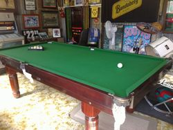 POOL TABLE 8' X 4' HARDLY USED.  MAHOGANY CARVED ADJUSTABLE LEGS.  EXCELLENT CONDITION.  COMES WITH...