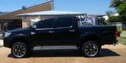 """Black. Manual. Turbo Diesel. 3"""" Exhaust. 2"""" Body Lift. 20"""" wheels. Dual Batteries. Andersen Plugs."""