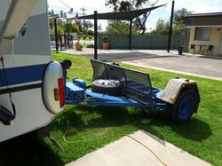 GYPSY Car Caddy, blue, i.g., 2 wheels on trailer and 2 wheels on road, new brakes and bearings, g...