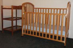 Timber Dropside Cot, castors, new mattress. C/table has foam change mat, 2 castors.