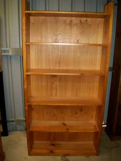 tall pine with 5 shelves. Can deliver.