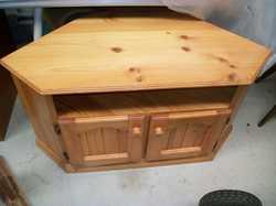 compact pine corner unit with shelf & 2 door storage $50. Can del.