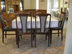 polished timber dining table with 6 padded chairs all in good condition.  table is extendable from 1...