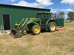 6010 JOHN DEERE 4 in 1 bucket + slasher, forks, & post hole borer, A/C cab, radio, recently r...