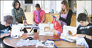 """Hard at work at """"sociable guerrilla bagging"""" in Bangalow are (left to right) Tom Lockhart, Zoey Hopkins, Mahalia Taal, Erin Wes"""