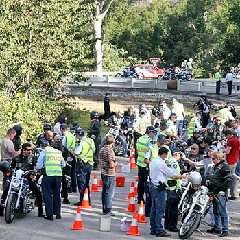 Bikie Blitz:Police interview participants in the Black Uhlan's poker run on Saturday as part of Operation Hotel Indicate. Photo:Contributed