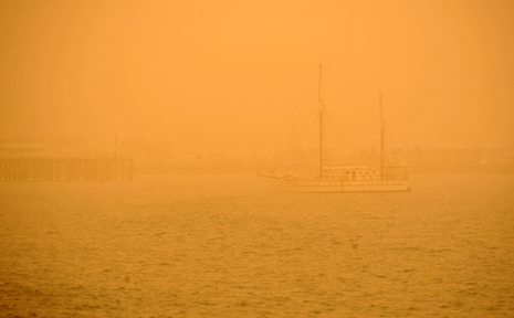 A yacht sailing into Coffs Harbour Jetty could barely be seen through the thick dust at around 9am this morning.