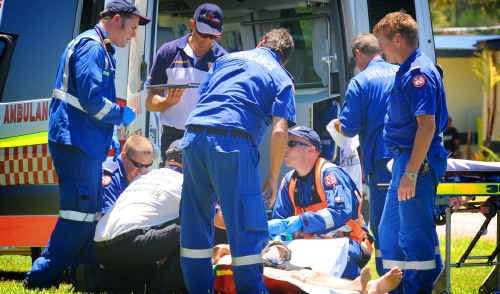 Ambulance officers treat the man at the scene of Wednesday's freak ski accident at Seelands. The man died in a Brisbane hospital on Thursday.